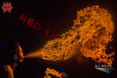 Wiliam Ellis fire breathing at Twisted Tuesday (AJ Hge Photography) Tags: ajhgephotography ajhegephotography 2016 redlionpub community men man perform performer performance night florida twistedtuesday canon 60d orlando furtographer winterpark fun talent light artist human people skill fire flame heat hot outside street prime primelens centralflorida firebreathing firebreather firebreath firebreathers breath exhale williamellis dragon