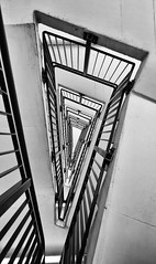End Of A Day by Simon & His Camera (On Explore 19th Aug 2016) (Simon & His Camera) Tags: stairs lookingup bw blackandwhite monochrome architecture contrast triangle lines vertical vertigo black white city geometric indoor metal pattern simonandhiscamera tower urban building explore