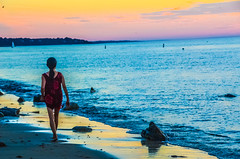 Sundown; alone with her thoughts.... (tomk630) Tags: woman red sundown cape cod colors light nature water sky muted beach