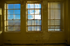 High Blues and Shadowed Oranges (imkaifilbey) Tags: nashville tennessee blue sky inside window interior yellow orange blinds old abandoned
