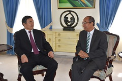 Minister without Portfolio in the Ministry of Economic Growth and Job Creation, Hon. Dr. Horace Chang, in discussion with Chairman of the China Development Bank, Hu Huaibang