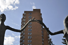 Calgary (hold hands) (Julia Mora Crespo) Tags: nikon nikond5000 canada trip travel calgary city sculptures statues longpeople hands holdhands building sky street
