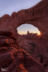 Through the Window (Ryan C Wright) Tags: park winter sunset southwest nature photoshop landscape photography utah sandstone december arch national moab archesnationalpark 2012 sunstar northwindow turretarch exposureblending verticalcomposition iloveloons