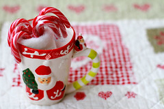 20/24-2012. Christmas cup (Isabel Pava) Tags: santa christmas red stilllife advent calendar getty santaclaus gettyimages candycanes gettyimagesiberiaq3 micalendariodeadviento gettyimagesiberiaq12012