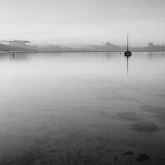 Calm (mpb11) Tags: ocean longexposure sea sky blackandwhite bw reflection water coral clouds sailboat island boat monotone lagoon catamaran tahiti bungalow moorea frenchpolynesia