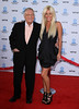 Playboy boss HUGH HEFNER has wed his girlfriend CRYSTAL HARRIS. / WENN.com
