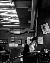 Across The Table... (Charn High ISO Low IQ) Tags: bw monochrome canon eos reading blackwhite cafe coffeeshop seoul southkorea lightandshadow photoshopelements koreangirl 600d orientalbeauty