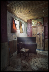 the missing pianist (biancavanderwerf) Tags: travel light france abandoned window stone dark poster decay piano flags dirty urbanexploration ugly bianca urbex