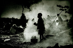 Boy in Smoke : Goma : Rwanda and the Democratic Republic of Congo Border (jezblog on Flickr) Tags: bw white black republic rwanda congo democratic jez drc coulson
