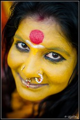 Yellow Face (ujjal dey) Tags: smile lady dreams hyderabad sankranti shallowdepthoffield ujjal nikon35mm yellowface shilparamam nikond90 ujjaldey ujjaldeyin sankranti2013