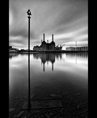 Battersea Power Station (esslingerphoto.com) Tags: longexposure greatbritain england sky bw white black reflection building london tower wet water station thames architecture clouds canon river photography eos europe long exposure power shot britain capital great architectural abandon single 5d battersea mkii esslinger esslingerphotocom