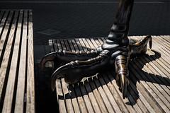 Sparrow (johnjackson808) Tags: falsecreek fujifilmxt1 olympicplaza vancouver bench bird housesparrow publicart sculpture streetphotography