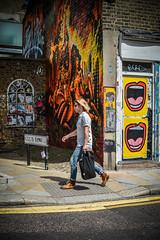 Club Row Art (sara.wendelmelhuish) Tags: urban mural wall streetart graff graffiti art streetphotography londonphotography walking eastend shoreditch london bricks door shopfront posters retail mouth laugh smile