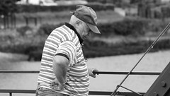 Fisherman (patrick_milan) Tags: noiretblanc blackandwhite noir blanc monochrome nb bw black white street rue people personne gens streetview homme man viril beau boy garon beautiful portrait face candide
