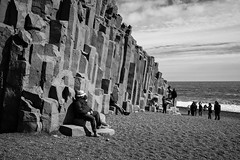 Relaxing on the beach (michael.mu) Tags: leica m240 iceland 35mm leicasummicron35mmf20asph reynisfjara beach blackandwhite monochrome basalt columnarbasalt outcrop blacksand volcanic nordicvisitor silverefexpro vik geology