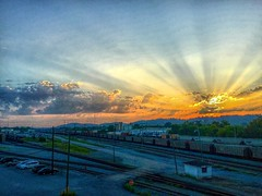 A Chattanooga Choo-Choo Sunrise (Roland 22) Tags: light flares rays flickr trains morning dawn clouds glow orange yellow golden ripples sunrise trainyard railroad chattanoogatennessee