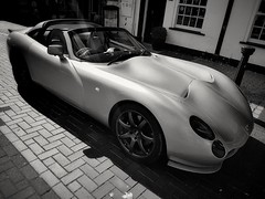 TVR (aistora) Tags: car auto automobile automotive sport sports racing coupe cabrio cabriolet roadster power speed speedy fast streamlined elegant design silhouette style stylish curves sexy body bw blackandwhite mono monochrome film filmlike filmemulation analog analogue silver grain grainy contrast paper print mobile phone cellphone smartphone samsung galaxy s7 samsunggalaxys7 android app snapseed tvr tuscan tuscans batmobille