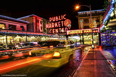 Holiday Fare (TIA International Photography) Tags: auto road seattle christmas street city travel winter light urban holiday motion blur cold building tree tourism wet lamp car shop pine night tia season landscape lights restaurant evening washington store cafe slick automobile stream neon december glow place pacific northwest market pavement cab taxi centre trails landmark center tourist sidewalk trail wreath lamppost evergreen rainy transportation sound vehicle pike wintertime fare puget christmastime tosin taxicab arasi tiascapes tiainternationalphotography