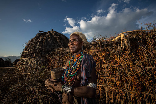 portrait of a old woman of the tribe Erbore at sunset