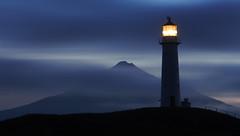 The Blue Hour (blue polaris) Tags: new morning blue light lighthouse house mountain island dawn volcano cone north olympus zealand maritime nz cape omd taranaki egmont em5