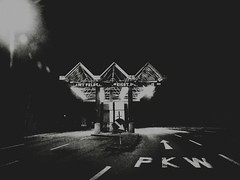 Swiss-Austrian Border (Yves Roy) Tags: street city shadow urban blackandwhite bw black contrast dark austria switzerland blackwhite raw moody darkness noiretblanc 28mm border snap fav20 gloom fav30 yr enigmatic customs grenze fav10 ricohgrd grdiii bureboke yvesroy yrphotography ghostborder