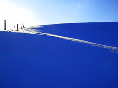 january blues (forester.jake) Tags: old blue mountain snow field fence landscape vermont farm hill january meadow blues windswept stowe hillside slope vt fenceline hff