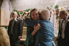 Kim and David (drflysuperfunk) Tags: christmas family trees winter wedding decorations red people white church candles catholic afternoon cross 14 ceremony marriage fujifilm service 1855 35 sanctuary byzantine naturallighting ois uniting xe1 lensrentalscom ef42 xf35mm xf1855mm