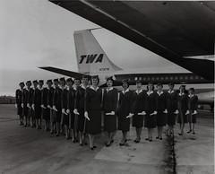Stewardess  in front of plane (San Diego Air & Space Museum Archives) Tags: boeing 707 stewardess twa stewardesses boeing707 b707 17658 transworldairlines 9qcbd 707131 airfret womenofflightphoto n731tw fbuzj 9qckp boeing707131 cn17658 boeing707131c 707131c lukimairservice cn1765818 1765818 stewardessinfrontofplane