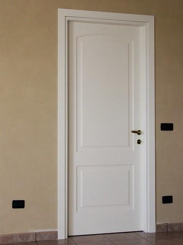 Porta interna pantografata due pannelli laccata bianca