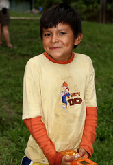Amazon Boy (cowyeow) Tags: poverty travel boy portrait silly cute peru latinamerica southamerica boys smile kids river children happy amazon rainforest funny village child sweet candid poor young shy jungle tropical littleboy coy loreto peruvian madreselva amazonriver