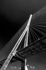 """just one huge support of the amazing Pont de Normandie, Normandy, France, in fine art style, contrasty B&W (grumpybaldprof) Tags: ocean road bridge sky france lines rock river concrete amazing traffic piers angles cables huge normandie honfleur normandy hdr impressive patters altantic bwhdr """"riverseine"""" """"normanfoster"""" """"seine """"laseine"""" """"pontdenormandie"""" """"longestuntil2004"""" """"bridgeofnormandy""""""""cablestayed"""" """"cablestayedroadbridge"""" """"lehavre"""" """"michelvirlogeux"""""""