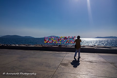 Balloons (`ARroWCoLT) Tags: nokia lumia 1020 contralight istanbul maltepe water reflection purple red su deniz sea boat tekne trkiye turkey turkei arrowcolt art manzara landscape outdoor cellphonephotography mobile baloons ship sky people silhouette flare lightbeam sunshine