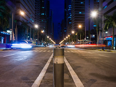 Caught in the middle (Blue Nozomi) Tags: emerald ortigas road blue hour light trails pedestrian manila philippines