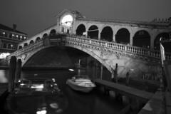 Ponte di Rialto (Curtis Gregory Perry) Tags: venice rialto bridge venezia italia night longexposure black white bw water grand canal nikon d800e boat dock ponte