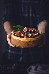 Holding a cake (Arx0nt.) Tags: food cake cheesecake man male holding hands tasty delicious yummy sweet grape fruit fig freshness toned soft homemade bakery pastry cozy comfort home concept vertical purple orange green xmas christmas holiday