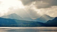 Sunlit Arrochar Alps (brightondj - getting the most from a cheap compact) Tags: scotland trossachs lochlomond loch water mountains arrocharalps sunlight sunbeam clouds