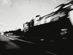 100 mph (Yves Roy) Tags: street city shadow blackandwhite bw black contrast dark austria blackwhite interestingness interesting raw moody darkness noiretblanc fav50 28mm snap fav20 freeway gloom 100mph fav30 yr fav10 fav40 ricohgrd blackwhitephotos grdiii yvesroy yrphotography