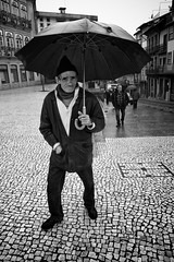 Mr. Like the weather (Fernando_PC) Tags: street men portugal rain standing umbrella blackwhite eyecontact flickr close mr candid streetphotography sidewalk baixa guimares x10 inyourface gettingclose streetphotographer 500px mrseries guimaraes fujifilmx10 fernandopc