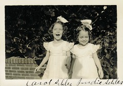 It looks like the tooth fairy must have stopped by their house (sctatepdx) Tags: sisters georgia snapshot smiles vernacular vintagedresses hairbows oldsnapshot vintagesnapshot judysehler carolsehler judithsehler judiesehler