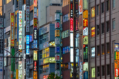 Sign Chaos (roevin   Urban Capture) Tags: street building public glass sign japan architecture facade train buildings shopping advertising lights tokyo evening construction neon cityscape view angle pov district steel low transport signage area kabukicho gable