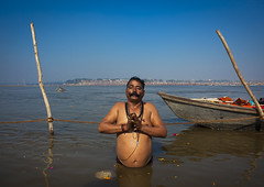 Pilgrim Bathing In Ganges, Maha Kumbh Mela, Allahabad, India (Eric Lafforgue) Tags: travel people india male tourism water festival river outdoors photography boat bath asia day adult religion praying bank bluesky event spirituality copyspace bathing riverbank hinduism pure pilgrimage adultsonly religiouscelebration pilgrim oneperson frontview sangam humaninterest allahabad socialgathering haridwar purification gangesriver yamunariver 1325 uttarpradesh menonly realpeople kumbhmela traveldestinations colorimage indianculture lookingatcamera fulllenght onemanonly uttarakhand maturemen indiansubcontinent celebrationevent traditionalceremony indianethnicity