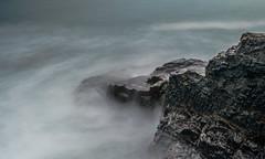 The Fog (intrazome) Tags: ocean longexposure sea mist black nature rock fog stone grey