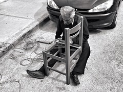 The street chair maker in mono (Spyros Papaspyropoulos) Tags: blackandwhite bw man monochrome streetphotography greece crete rethymno chairmaker uploaded:by=flickrmobile flickriosapp:filter=nofilter
