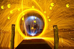 2012-11-28 RVG_9506 Pacman (ralphvandergeestfotografie) Tags: wood longexposure lightpainting water dark pier movement thenetherlands orb sparks afterdark zeewolde steelwool movementandmotion lightstencil nikond300 sb900flash ralphvandergeest ralphvandergeestfotografie