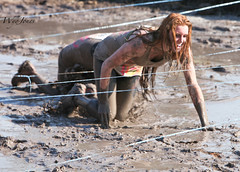 Dirty Girls having Fun (wyojones) Tags: woman usa cute beautiful fun pretty texas pants mud expression houston redhead laugh runner crawl obstacle muddy runningshoes mudrun tennisshoes minidress mudhole northhouston samhoustonracepark wyojones mightymuddash