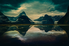 Through The Mists of Milford Sound (Stuck in Customs) Tags: new morning newzealand mountains southwest reflection texture water island south unesco zealand sound fjord milford february aotearoa vignette greenstone fiordlandnationalpark tewaipounamu 2013 piopiotahi tewhipounamu nikond800