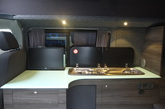 Combining Quality Appliances and Style (Leisure Hubs) Tags: lighting wood kitchen vw volkswagen shower tv bed rainforest conversion designer system dining comfort curved camper luxury campervan stylish reimo corian bebb