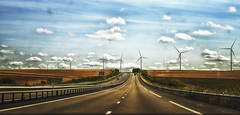 A long road to ... (garlick.rachel) Tags: road long landscape hdr windmills motorway autoroute highway route clouds fields drive car view windscreen autobahn network driving travel travelling straight