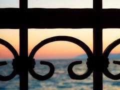 Dark fence (M.patrik) Tags: fence croatia sea blur bokeh dark symmetrical sunset geometry