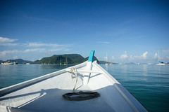 On the Water Again (-gunjan) Tags: landscape travel wanderlust ocean water sky boat philippines elnido sunset fisherman silhouette langkawi malaysia island
